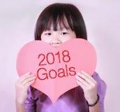 Tarjeta roja de la forma del corazón con las metas 2018 Imagen de archivo
