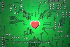 Tarjeta roja del corazón y de circuitos Fotos de archivo