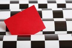 Tarjeta roja en blanco Fotografía de archivo