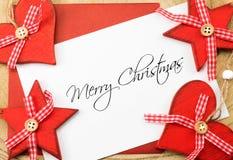 Tarjeta, rojo y blanco de felicitaciones de la Feliz Navidad Fotografía de archivo