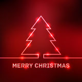 Tarjeta tipográfica de la Feliz Navidad que brilla intensamente Foto de archivo