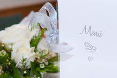 Tarjeta y flores del menú Imagen de archivo libre de regalías