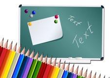 Tarjeta y lápices de escuela Fotos de archivo