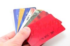 Tarjetas de crédito del asimiento de la mano Imagen de archivo libre de regalías