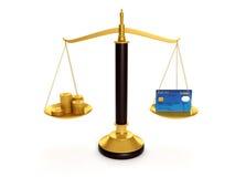 Tarjetas de crédito del balance y monedas de oro Foto de archivo libre de regalías