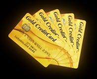 Tarjetas de crédito del oro ilustración del vector