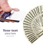 Tarjetas de crédito y dólares de fan Imagen de archivo libre de regalías