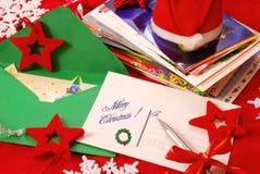 Tarjetas de felicitación de la escritura para la Navidad fotografía de archivo