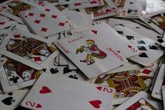 Tarjetas de mentira con la tarjeta seleccionada en el top como se?ora del comod?n fotografía de archivo libre de regalías