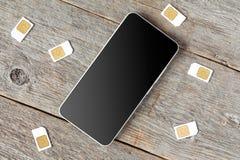 Tarjetas de Smartphone y de SIM Imagen de archivo libre de regalías