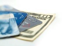 Tarjetas del billete de banco y de crédito Imágenes de archivo libres de regalías