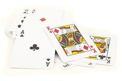 Tarjetas del póker adentro aisladas en blanco Imagen de archivo