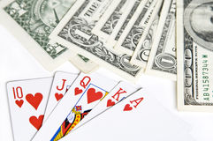 Tarjetas del póker y cuentas de dólar Imágenes de archivo libres de regalías