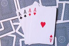 Tarjetas que juegan con 4 as Fotos de archivo libres de regalías