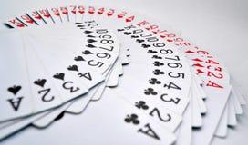 Tarjetas que juegan de los corazones, diamantes, clubs, espadas Imágenes de archivo libres de regalías