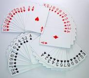 Tarjetas que juegan de los corazones, diamantes, clubs, espadas Fotografía de archivo
