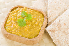 Tarka Dal. Indian yellow split pea curry garnished with coriander and served with chapatis Royalty Free Stock Photo