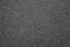 Tarmac background photo texture, road. Pavement consisting of crushed rock mixed with tar royalty free stock photography