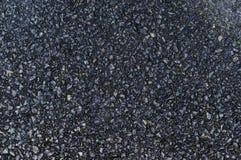 Tarmac. A close study of asphalt or tarmac Stock Image