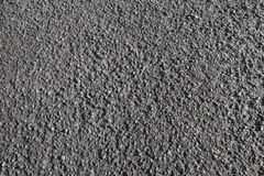 Tarmac. Dark road pavement texture. Tarmac. Dark road pavement consisting of crushed rock mixed with tar. Background photo texture stock photography