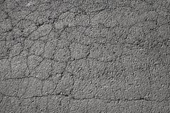 tarmac Pavimentazione di strada scura incrinata immagine stock libera da diritti