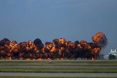 Tarmac Pyrotechnics at Oshkosh Airshow. Photo of fiery explosions set off at Oshkosh Airshow on tarmac as part of pyrotechnic show stock photography