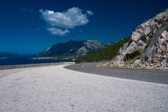 Tarmac Road near Orebic. At  Peljesac peninsula, second largest in Croatia (358 km2), located in south Dalmatia in Dubrovnik region, Adriatic sea at left Stock Photography