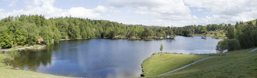 Tarn Hows Cumbria. Tarn Hows is a popular beauty spot in the English Lake District. This man made lake is formed from 3 smaller lakes. At one stage this was Stock Photography
