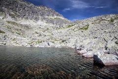 Tarn in mountains Stock Photo