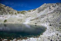 Tarn in mountains. Tarn - Wahlenbergovo pleso - in High Tatras mountains, Slovakia Royalty Free Stock Photo