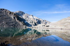 Tarn over the dolomites Stock Photos