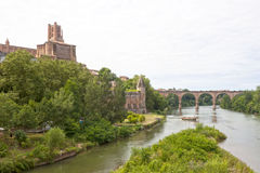Tarn river, Albi's cathedral, Berbie palace and a boat in Albi Stock Images