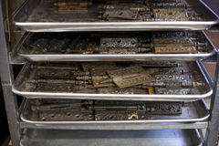Tarnished hinges dry out on shelving in a bookbinders studio. Stock Image