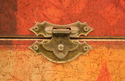 Tarnished Old Clasp. An old tarnished clasp fastening a lid to a box Royalty Free Stock Images