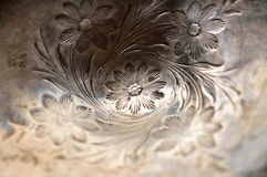 Tarnished silver carved flowers Royalty Free Stock Image