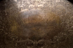 Tarnished silver scrollwork background Stock Image