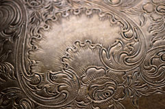 Tarnished silver scrollwork background Stock Photos