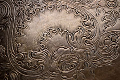 Tarnished silver scrollwork background Royalty Free Stock Photography