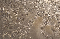 Tarnished silver scrollwork background Stock Photo