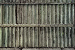 Tarnished Sliding Metal Gate Stock Photo