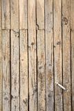 Tarnished Wooden Door. Exposed to air and moisture royalty free stock images