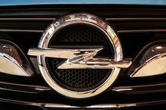 New Opel metallic emblem closeup. Tarnow, Poland - October 28, 2017: New Opel emblem on a car grill. Opel is a famous German automobile manufacturer that designs Royalty Free Stock Images