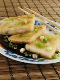 Taro Cakes in Sauce Stock Photo