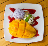 Taro ice cream with ripe mango Royalty Free Stock Image