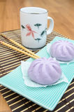 Taro Mantou Chinese steamed bun in green dish on bamboo mat Royalty Free Stock Photo