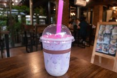 Taro Milk tea with pink Konjac bubble royalty free stock image