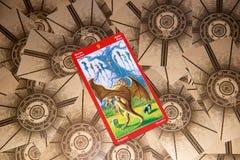 Tarokkort nio av svärd Draketarokdäck esoterisk bakgrund royaltyfria foton