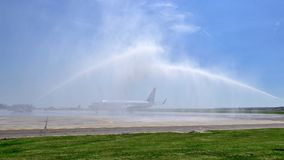 Tarom airplane first landing in Otopeni airport , water jets for inauguration Stock Image