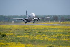 Tarom commercial airplane takeoff from Otopeni airport in Bucharest Romania. Plain spotters close up stock images