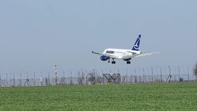 Tarom plane landing on runway, spring. Tarom plane landing on runway, airport stock video